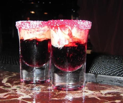 Jam Donut shot ~Coat the rim of a shot glass with sugar using sugar syrup to stick. Add the Chambord raspberry liqueur to the shot glass, and carefully layer the Bailey's Irish Cream on top.