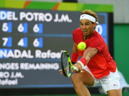 Rafael Nadal (ESP) returns a shot to Juan Martin Del Potro (ARG) in the men's…