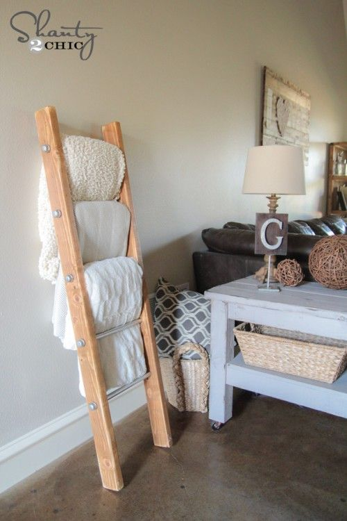 Blanket ladder! This is a #diy, but store-bought or not, this is a cute, tidy way to store blankets in your #living room