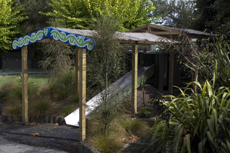 Shade Structure over slide with kowhaiwhai pattern.
