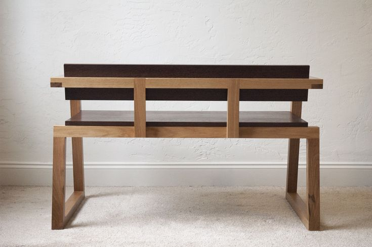 Boot Bench I designed this indoor bench to live in an entrance way or foyer. Its height and seating geometry make it a good place to sit down and pull on your boots. It can also act as a setee for...
