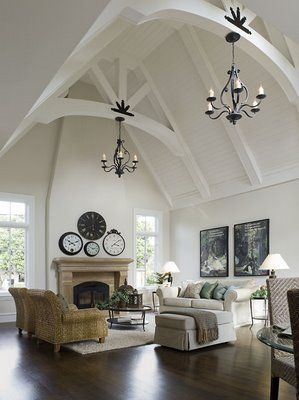 Cool idea of multiple clocks over fireplace if the ceiling is high