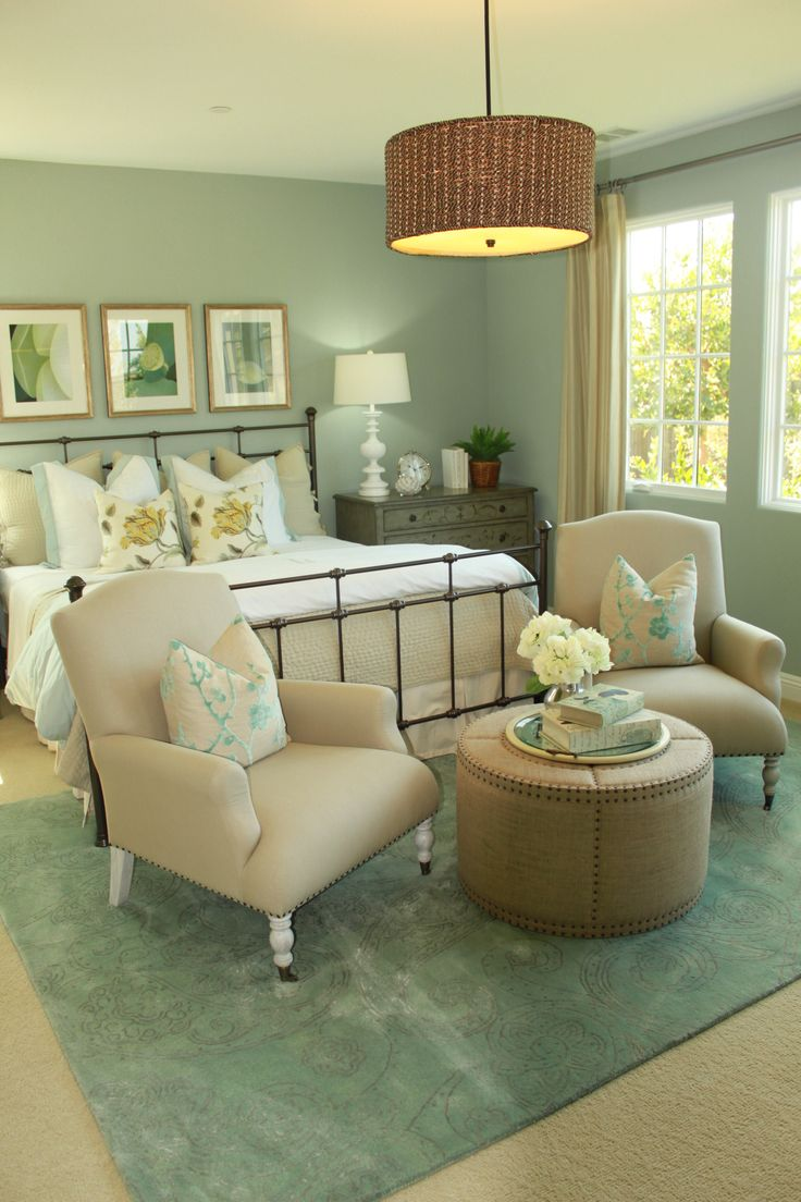 Guest room inspiration...seafoam/turquoise with natural colors; rod iron bed frame; 3 hanging 8x10 pictures on wall