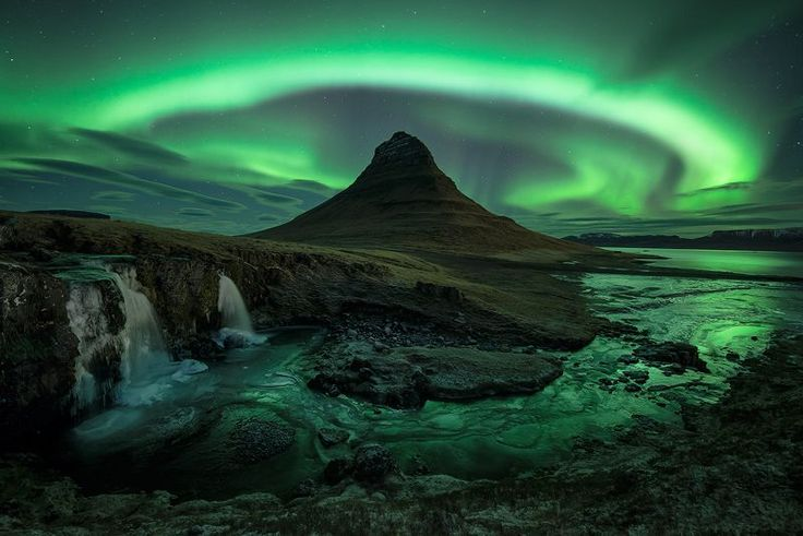 Aurora over Kirkjufell, Iceland - David Clapp. Some say the Aurora is the spirits of dead animals and men (in their true, animal form) as they spend their nights on dancing across the twilight sky. I may believe that it is caused by disturbances in the poles' magnetic field, but that doesn't destroy any of the magic,for me, it only adds to it.