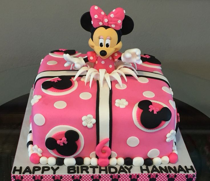 "Minnie Mouse cake made using a purchased 10"" doll. Doll is dressed in fondant dress and bow."