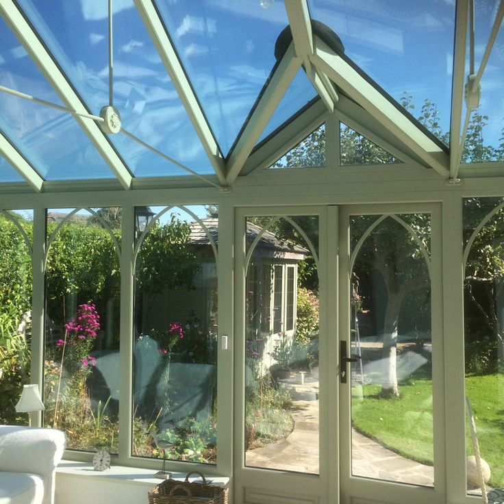 New conservatory painted in heritage green with self cleaning, soft coated, Aqua Blue, high performance solar reflective roof glass