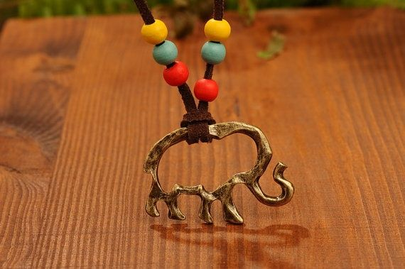 Elegant elephant necklace-Brass elephant pendant -colorful wood bead decoration and linked by leather chain from Picsity.com