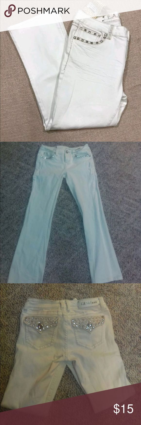 NWOT White La Idol BootCut Jeans Size 7 These LA idols were too small for me I took the tag off as I saw a small stain and washed it out the last picture reflects the faint stain  . You can't really see it the price reflects this LA IDOL Jeans Boot Cut
