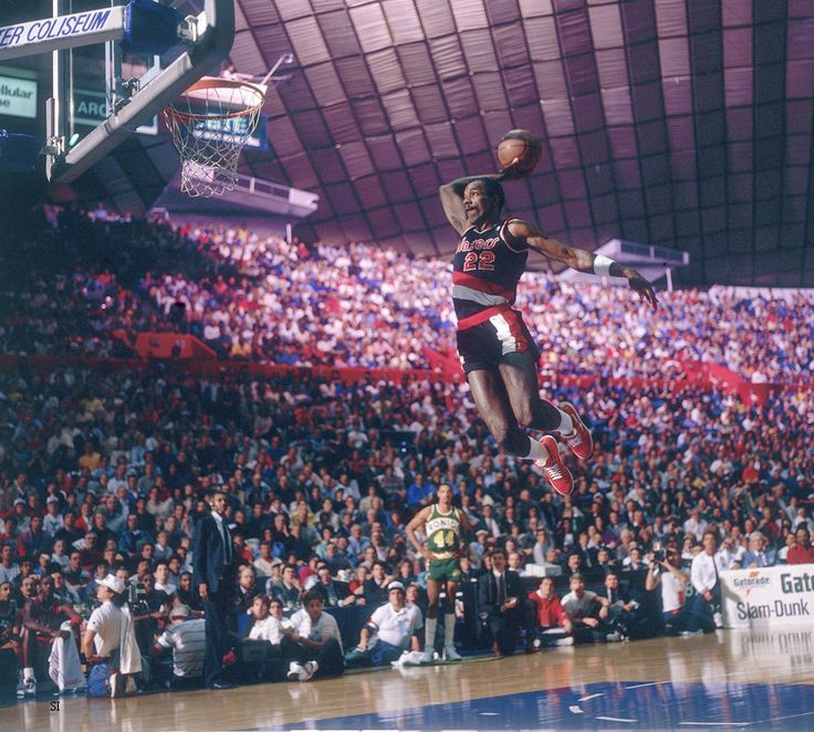 Clyde The Glide takes flight in the 1987 Slam Dunk contest in the Seattle Center Coliseum