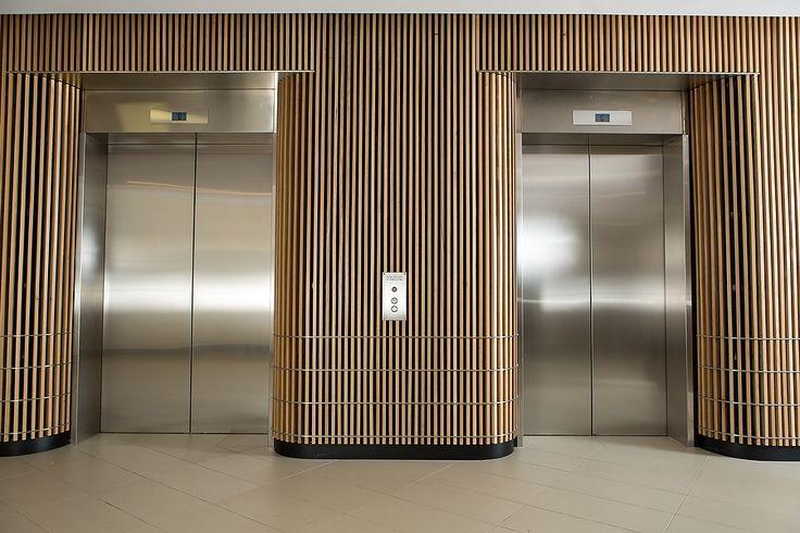 Office Entrance Foyer : American white oak corporate foyer wall ceiling