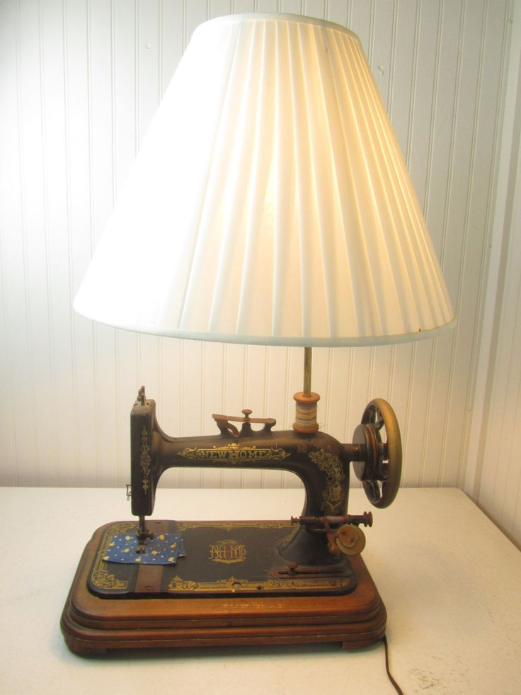 Very unique sewing machine table lamp. New Home sewing machine made in Orange Mass. This is a real sewing machine, made into a lamp. They did a very nice job and works great! The shade is negotiable, it will come with the lamp but will have to be shipped separate. If you dont need the shade I will adjust the shipping, $20.00 less. Size- 17 wide x 29 tall x 9.5 deep front to back