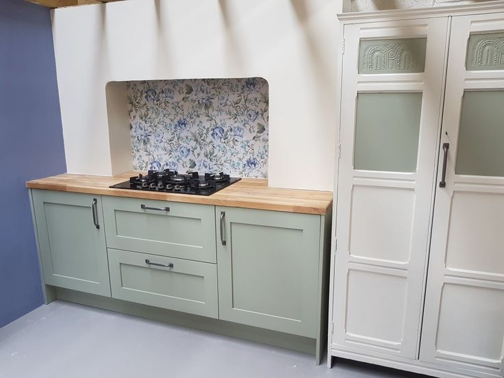 Hand made kitchen at My Furniture Box Swindon. Painted with Frenchic wise old sage and cream dream. B&Q wallpaper in false chimney, units made from 18mm plywood.  #chalkpaint