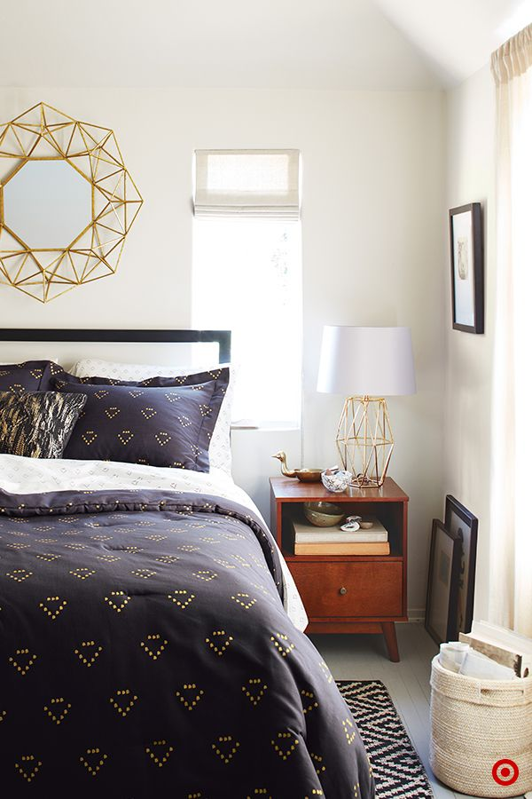 Set the scene for some serious beauty sleep with a bedroom update, courtesy of Nate Berkus' new collection. Using the comforter as the focal point, take cues from the pattern to find the right accents. A gold geometric mirror and matching lamp are the perfect complement to the shiny metallic print in this navy bedding. A small rug next to the bed adds warmth and ties the look together. Top it off with a toss pillow and nightstand decor for added shine.