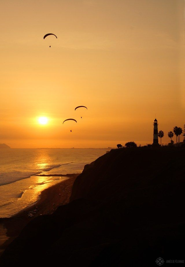 Sunset in Lima with paragliders on the coastline along Miraflores