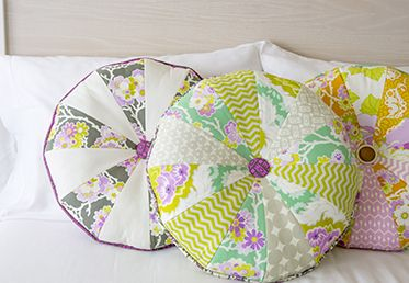 Round Button Cartwheel Pillow with Heather Bailey on Creativebug. Made with True Colors fabrics from the @FreeSpirit Fabric line.