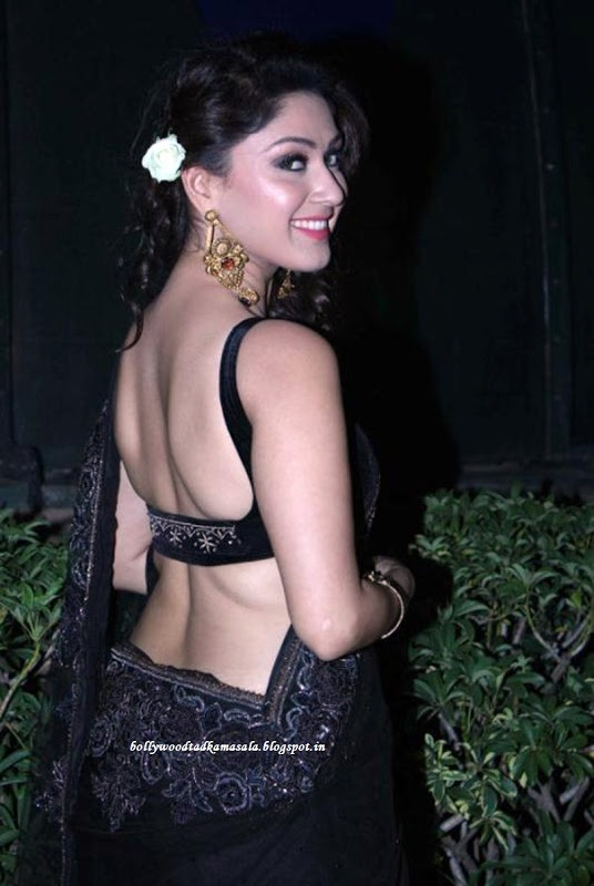 Manjari in black shows some back.
