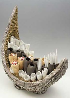 "Anthony Foo ""  Terra Nova, 2009  Paperclay, Southern Ice Porcelain paperclay, Black Mountain potters clay, Black Mountain Sculpture clay, Grogzilla sculpture clay, flashing slip, feldspar crystals, polymer clay(red), natural red seeds. Iron and Manganese oxide on outside of hull. No glaze. High fire - Cone 10 reduction. 22""H x 19""W x 10""D"" ~ from website"