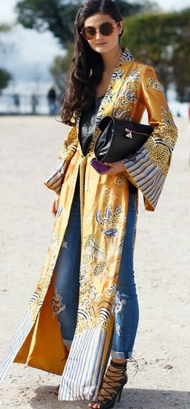 That' a fascinating Outfit! Jeans, Gladiator Heels and those sunny kind of Kaftan.