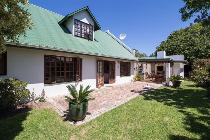 This charming home with a north facing aspect has a lovely entertainment area and built in braai in the attractive front garden.  Open plan living areas make for easy entertaining, while the four...