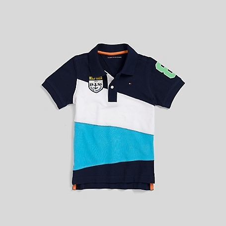 Tommy Hilfiger big boys' polo. We've topped off this polo with signature Tommy touches—vintage collegiate appliqués and stand out stripes. Soft breathable pique cotton in a time honored construction. 100% cotton. Machine washable. Imported