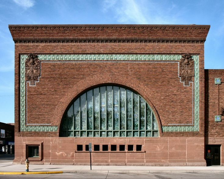 See.  National Farmer's Bank, Owatonna, MN. Designed by Louis Sullivan, 1908.