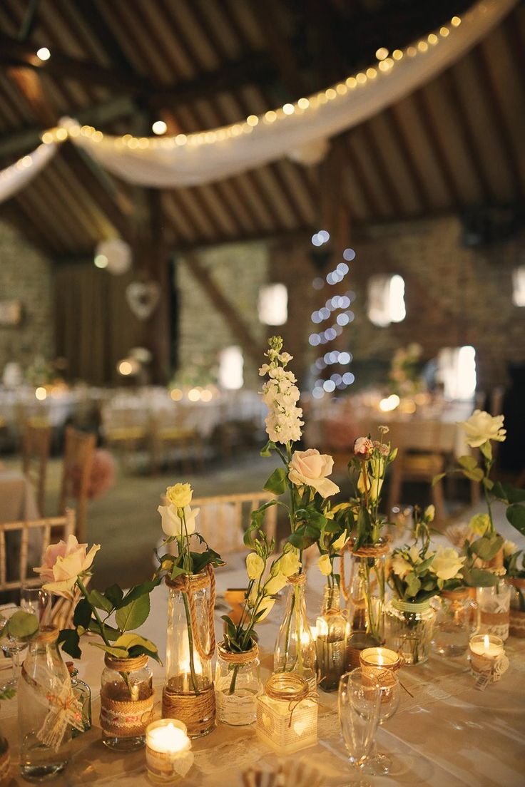 Candles Tea Lights Flowers Jars Stylish Pastel Rustic Barn Wedding http://helenrussellphotography.co.uk/