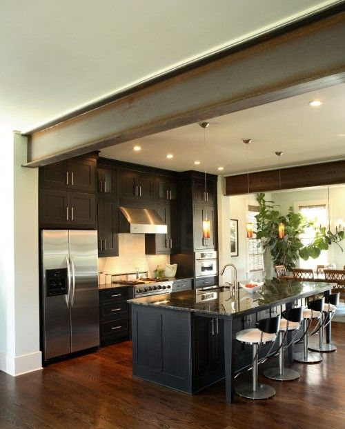 steel beam - I LOVE the contemporariness (I don't think that's a word, but...) of this kitchen.
