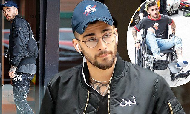 Zayn Malik steps out without a wheelchair after injuring his foot