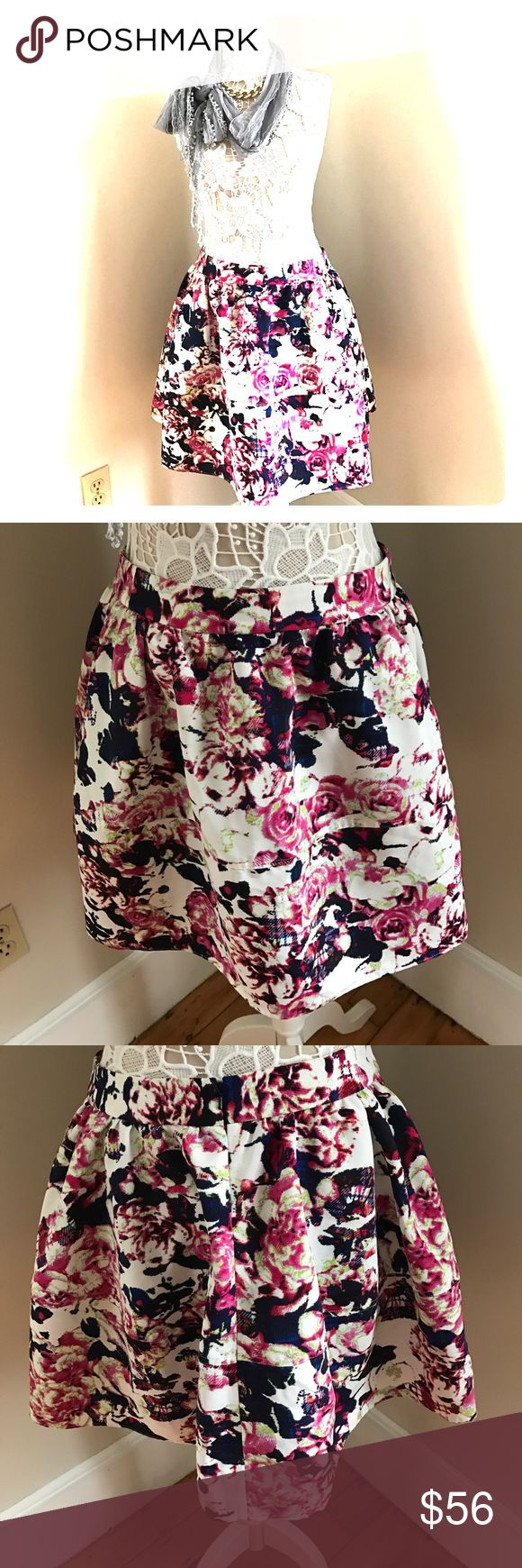 Express flower skirt This beautiful chic skirt is yours for the taking, dress me up anytime Express Skirts Midi