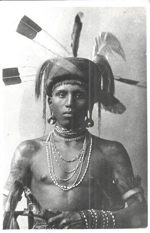 Dayak warrior. Postcard, British North Borneo.