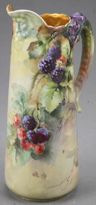 """Limoges porcelain pitcher/tankard marked """"J.P. L France"""" (Jean Pouyat), hand painted berries and leaves on vines decoration and a dragom figural handle. France, circa 1890-1930"""