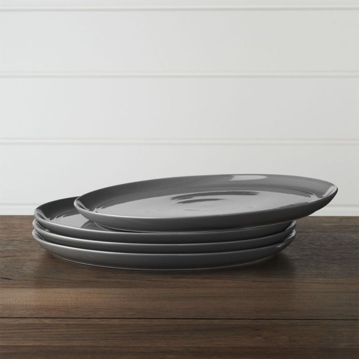 Shop Set of 4 Hue Dark Grey Dinner Plates.  Our fresh, contemporary porcelain pattern from designer Aaron Probyn tells a mix 'n' match color story, hand-glazed in seven soft, soothing hues.