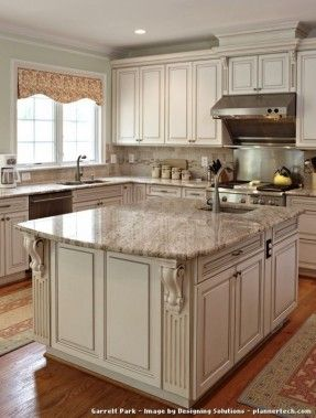 Kitchen Photos Design:  Marsh Cabinets in ivory with a chocolate