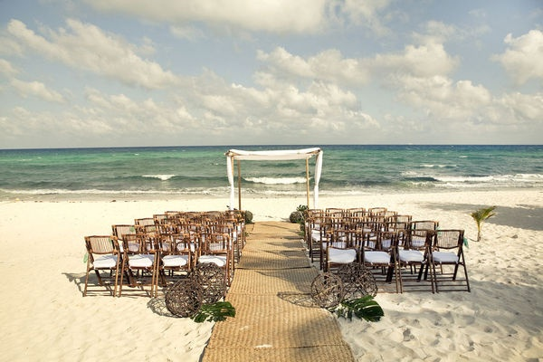 Love the simplicity of this Beach Wedding were the surroundings are your decorations!