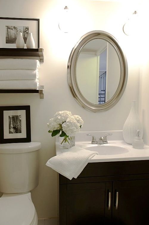 This would be a great look for our tiny bathroom!  It would also provide more storage space without being hard on the eyes.
