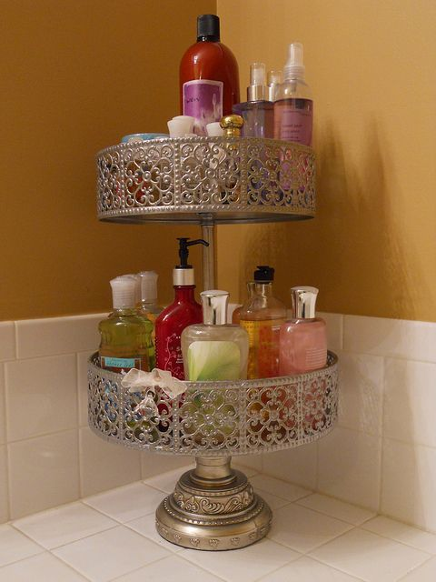 Use cake stands or tiered plant stands to declutter your bathroom counters. Great idea!