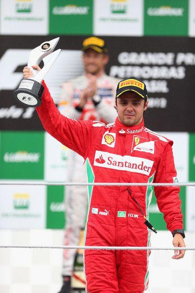 Felipe Massa of Brazil and Ferrari reacts on the podium after finishing third
