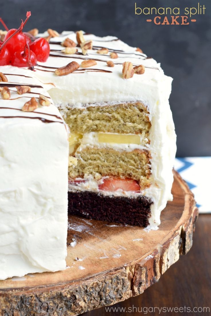 Banana Split Cake: layers of chocolate cake, banana cake, fresh fruit and whipped cream frosting for an ultimate, decadent cake recipe!: