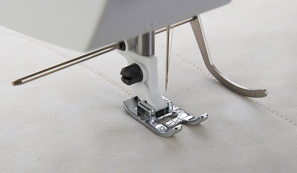 The Edge Quilting guide is used for wide seam allowances, pintucks, topstitching, or channel quilting.