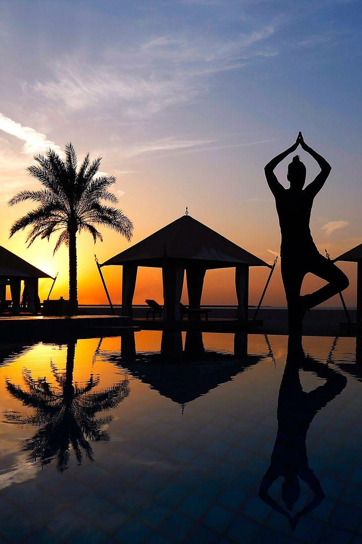 Yoga at sunset at Ras Al Khaimah beach resort, UAE