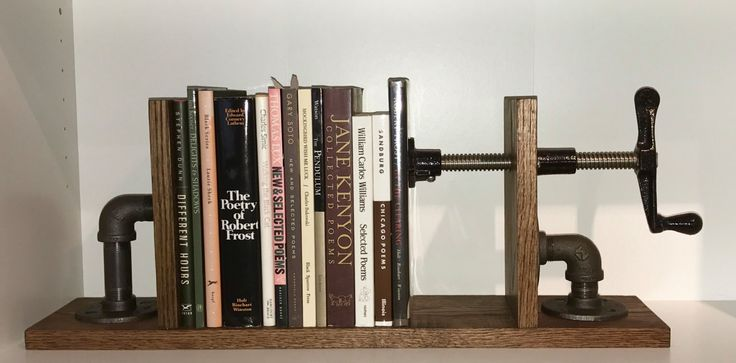 Adjustable Industrial Bookends by thenakedroom on Etsy https://www.etsy.com/listing/479098936/adjustable-industrial-bookends