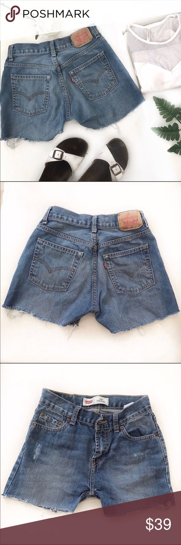"""LEVI'S 514 jeans cut-off shorts size 24 Vintage feel. Classic and trendy at the same time. Keep up with the Jenners and Hadids with this timeless Levi's cutoff jean shorts.  Waist 24"""" Rise 8.5"""" Inseam 3""""  Tags: vintage , distressed , mom jeans , reformation , re/done , wedgie , jenner , hadid , rare , cutoff shorts , summer Halloween costume Levi's Shorts Jean Shorts"""