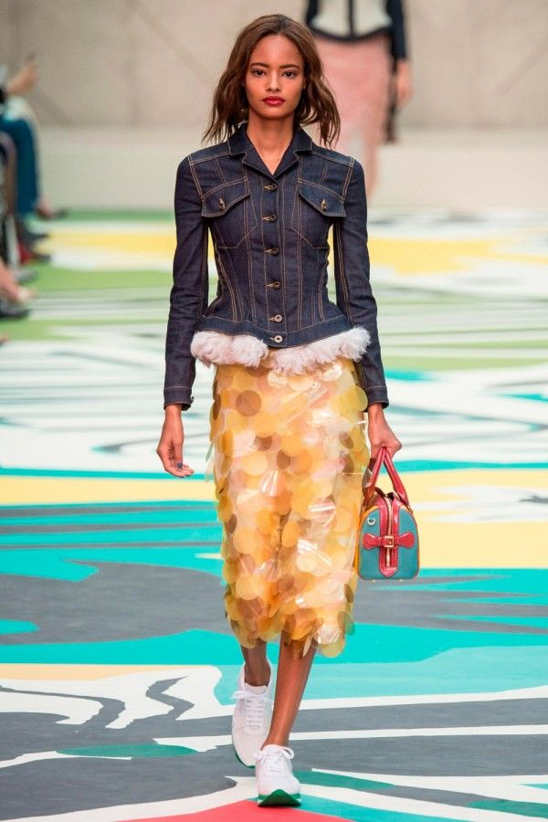 Burberry set the tone for SS15 at London Fashion Week with its high-low fashion combo of sequin skirts, denim jackets and running trainers. Divine... po.st/RfYIed