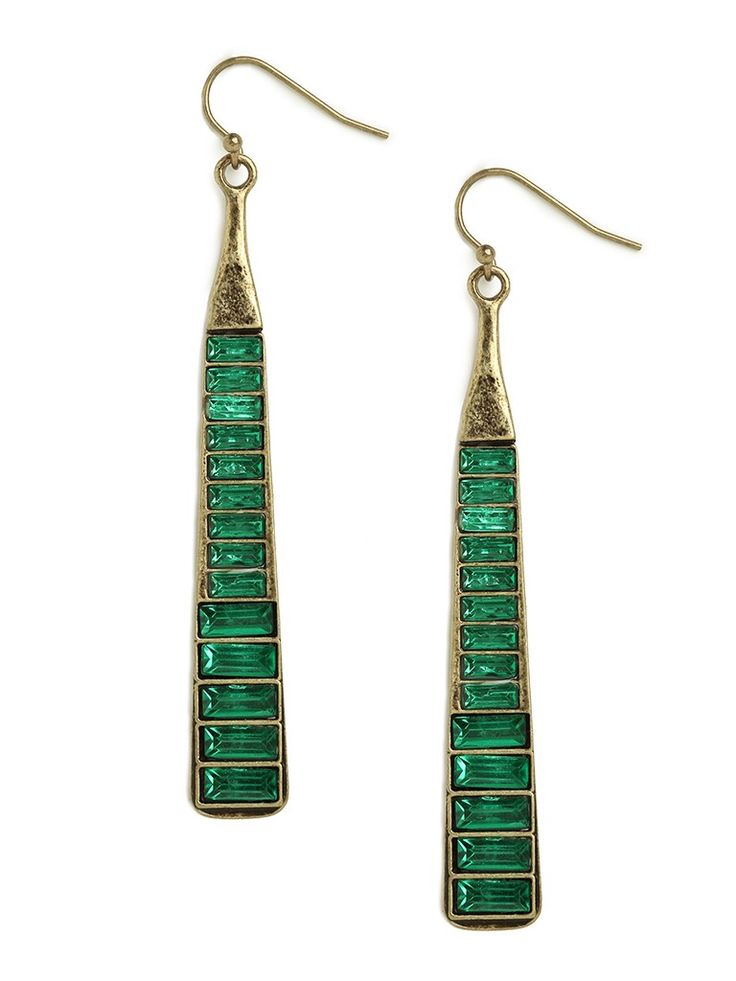These stunning statement earrings channel a truly jet-set, I'm-headed-to-Saint-Tropez vibe. It's all in that long elegant silhouette that flaunts superb baguette-cut emeralds set into gold.