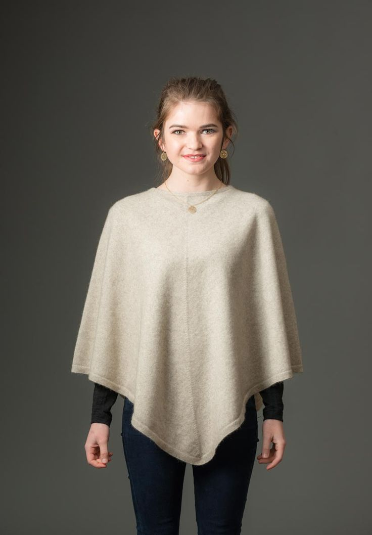 This natural beige possum merino wool cape is gorgeous and it looks even better teamed with the beige fur trimmed wrist-warmers that match. A luxury blend of 20% possum fur mixed with 70% merino lambs wool and 10% silk in natural beige. Made in New Zealand.