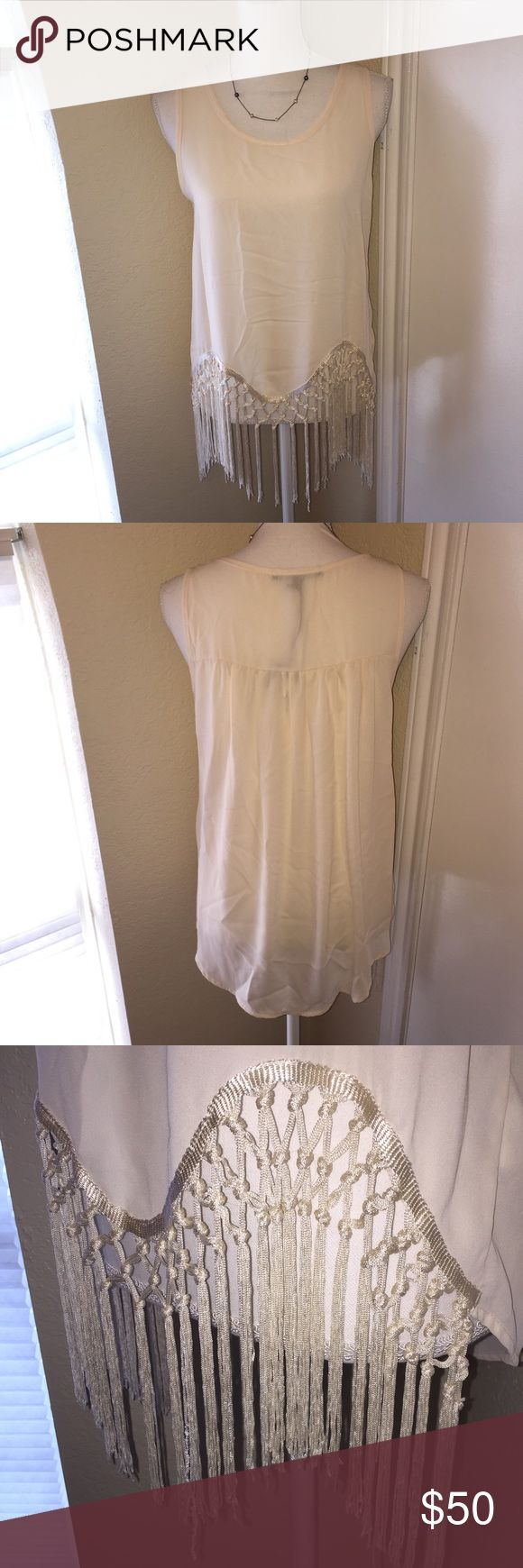 Romeo + Juliet Couture IVORY Fringe Blouse Simply chic, this off-white top is airy and feminine. Perfect for Sunday brunch or to be paired with leggings. Made unique by the woven threading and long back. NWT tag damaged to prevent returns. Some barely noticeable pulling on some of hanging threads in the bottom fringe. Pictured above. Romeo & Juliet Couture Tops Blouses