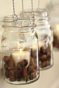 candles with acorn filler. cute decor. Also have acorns spread around centerpieces on tables?