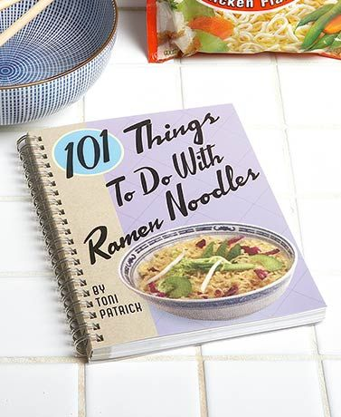 """The perfect college student cookbook! You'll find 101 recipes inside that all have one common ingredient--Ramen noodles. Book (7-1/4"""" x 5-1/2"""") has 120 pa"""