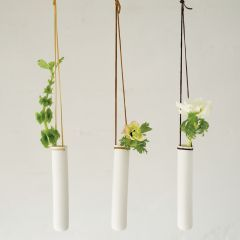 Better than a mobile! Fresh plants/ flowers are interesting to look at and straps come in all colors!