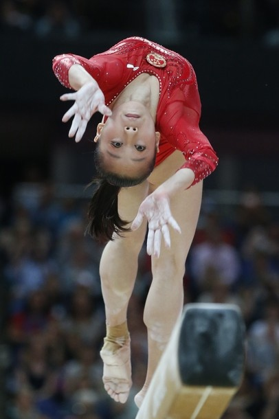 China's Sui Lu performs during the women's beam competition of the artistic gymnastics event of the London Olympic Games on August 7, 2012 at the 02 North Greenwich Arena in London. China's Deng Linlin won gold while Sui Lu won the silver medal, with Alexandra Raisman of the United States taking the bronze medal.